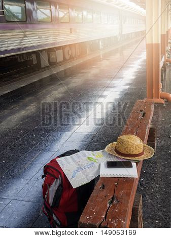 Tourist belongings on floor at Chiang Mai train station Thailand