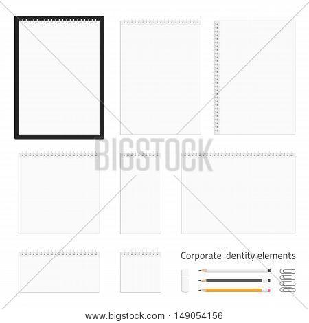 Corporate identity template set. Business stationery mock-up. The album, notebook, desk calendar, magazine, clipboard, pencils, pen, USB flash drive and paper clip.