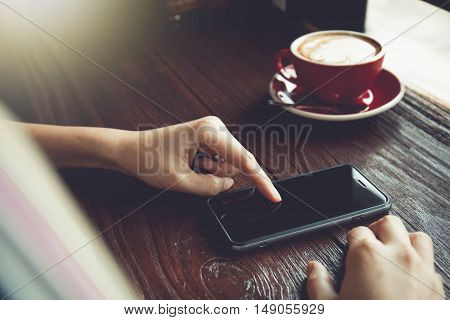 people using smart phones in cafe. Vintage Toned picture