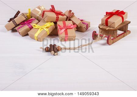 Wooden Sled And Wrapped Gifts For Christmas Or Other Celebration, Copy Space For Text