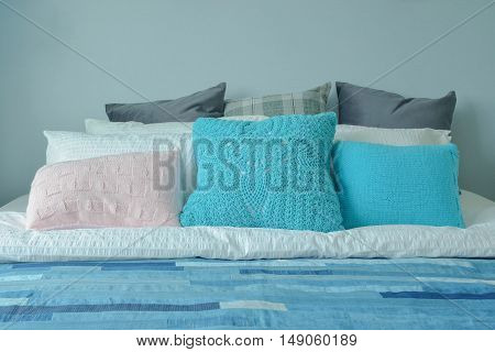 Blue Color Scheme Teenager Bedroom With Colorful Pillows On Bed