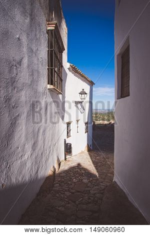 Old cobbled streets with white houses portrait