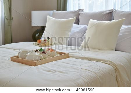 Bedroom Interior Design With Decorative Tea Set And Dessert On Bed
