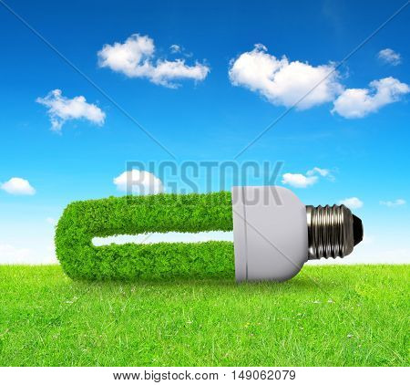 Eco light bulb in grass - green energy concept