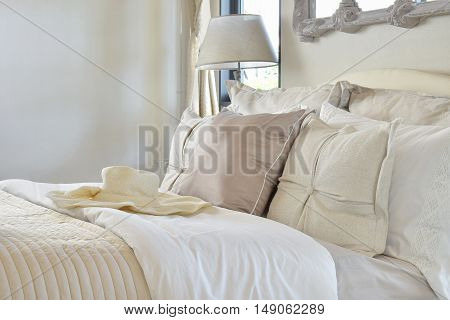 Luxury Bedroom Interior With Decorative Set With Vintage Bag,hat,books On Bed And Classic Style Tabl