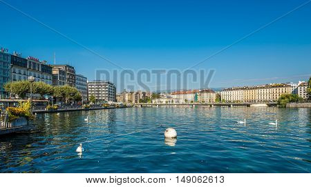GENEVA,SWITZERLAND - AUGUST 27,2016 - Rhone River flowing out of Lake Geneva. Geneva is a global city a financial center and worldwide center for diplomacy.