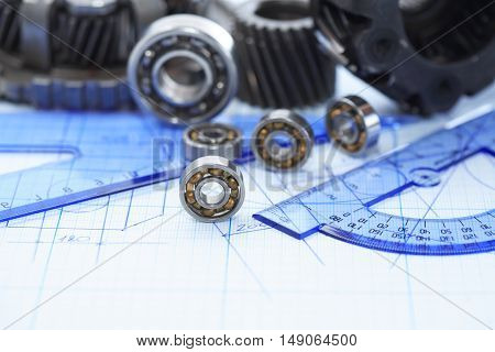 Engineering concept. Set of gears on blueprint