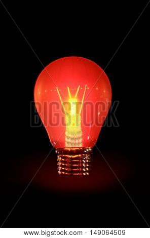 Power and energy. Glowing electric bulb on dark background