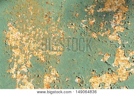 Rusty painted blue metal with cracked paint. Texture grunge background