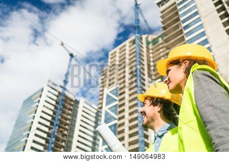 Construction engineers supervising progress of construction project