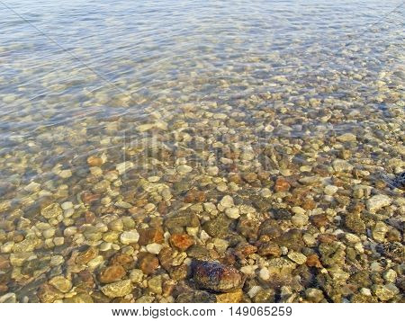 Untouched nature abstract archipelago in seashore with rocks in water on Dead sea . Israel