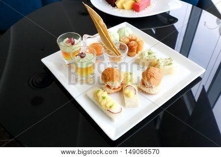 Asian high tea platter mini fish burger dim sum spring roll open egg sandwich