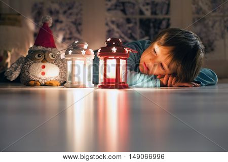 Beautiful Little Boy, Lying Down On The Floor, Looking At Candles, Making Wishes