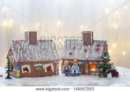 Two Gingerbread Houses, Tree And People Sitting On A Bench, Winter Scene