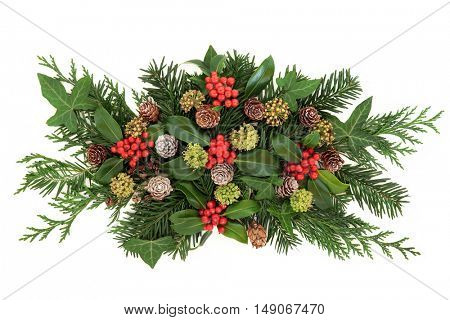 Winter and christmas decoration with holly, ivy, pine cones , cedar cypress and fir leaf sprigs over white background.
