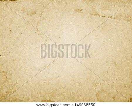 Aged dirty yellowed and stained paper texture. Natural paper material for the design.