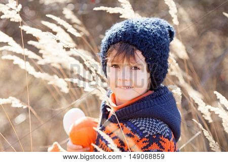 Cute Little Caucasian Child, Boy, Holding Fluffy Toy, Hugging It, In The Park