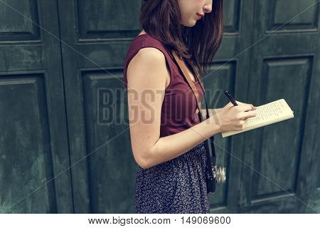 Woman Making Notes Outside City Concept