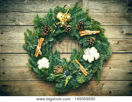 Christmas wreath on the rustic wooden background