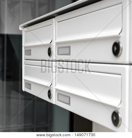 Four modern mailboxes of an apartment building (shallow DOF).