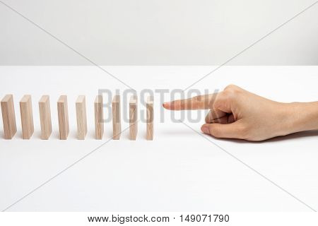 a woman hand with a wooden games