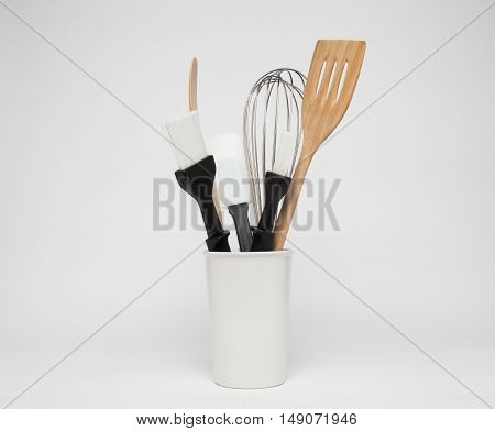 Baking and cooking tools in a white jars
