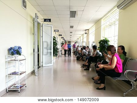 Hanoi, Vietnam - Sep 27, 2016: Asian patients waiting for their turns to be examined at Hanoi Medical University Hospital of the same name university.