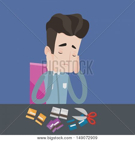 Young caucasian businessman cutting his credit card. Depressed businessman sitting at desk and cutting credit card with scissors. Concept of bankruptcy. Vector flat design illustration. Square layout.