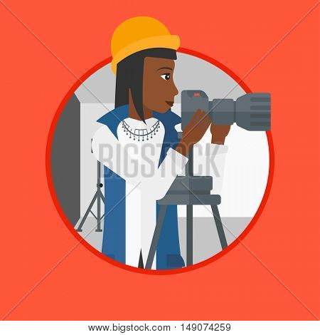 An african-american photographer working with camera on a tripod in photo studio. Woman taking photo with professional camera. Vector flat design illustration in the circle isolated on background.