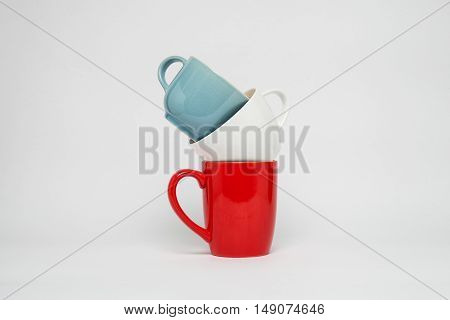 three color cups on a white background
