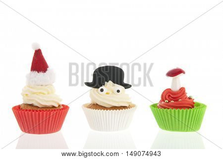 Home made cupcakes for Christmas with mushrooms, hat of Santa Claus and snowman