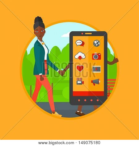 An african-american woman walking with a big smartphone. Woman and a big smartphone in the park. Woman holding hand of smartphone. Vector flat design illustration in the circle isolated on background