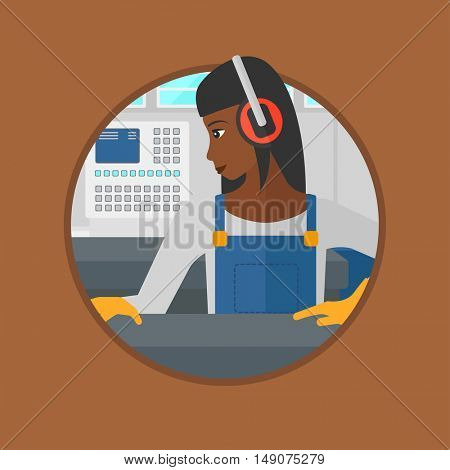 An african-american woman working on metal press machine. Worker in headphones operating metal press machine at factory workshop. Vector flat design illustration in the circle isolated on background.