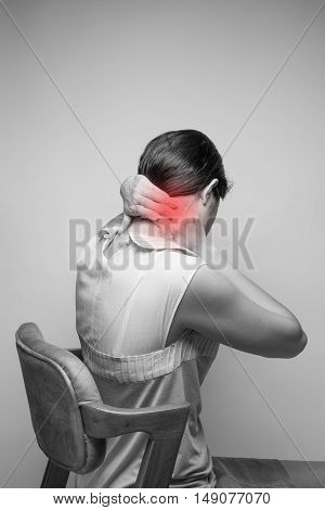 Young woman having pain in the neckPain in the neck