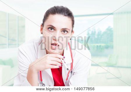 Closeup Portrait Of Serious Doctor Smoking Cigar