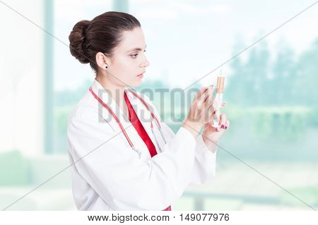 Woman Doctor Preparing Medical  Syringe