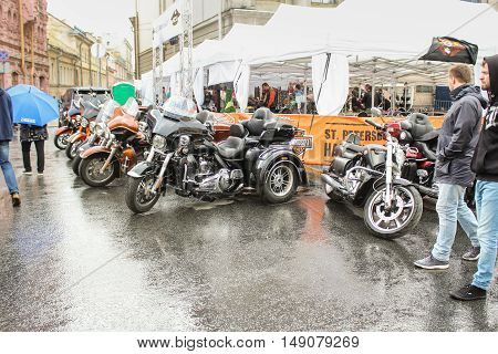 St. Petersburg, Russia - 12 August, Motorcycles parked on wet,12 August, 2016. The annual International Festival of Motor Harley Davidson in St. Petersburg Ostrovsky Square.