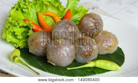 Tapioca balls with pork filling eat with chili