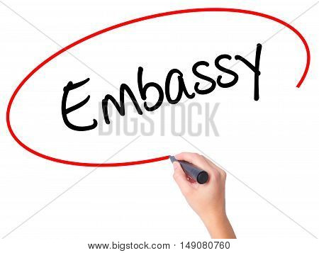 Women Hand Writing Embassy With Black Marker On Visual Screen