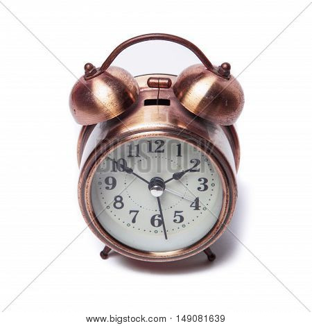 Brass metal alarm clock retro style on a white background