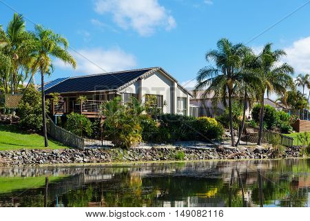 Stylish australian waterfront home on sunny day
