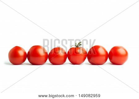 Set of six cherry tomatoes isolated on a white background. The concept of healthy nutrition, organic food, fresh vegetables, veganism