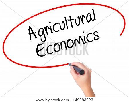 Women Hand Writing Agricultural Economics With Black Marker On Visual Screen