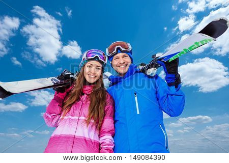 Young couple with skis outdoors