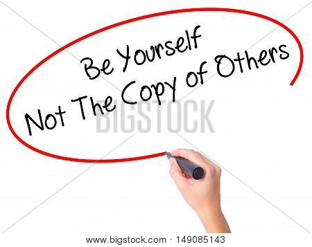 Women Hand Writing Be Yourself Not The Copy Of Others With Black Marker On Visual Screen