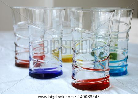 Colorful glass cups.Six brightly colored beverage glasses
