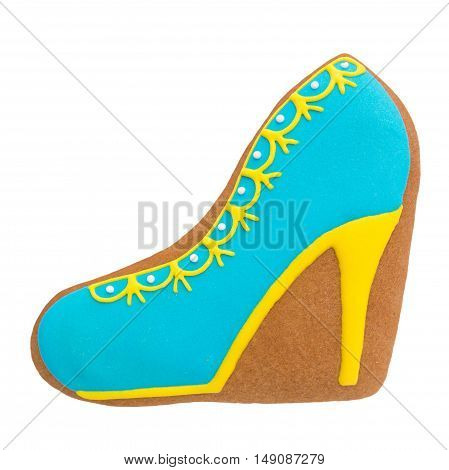 Glazed cookies shaped shoes on a white background