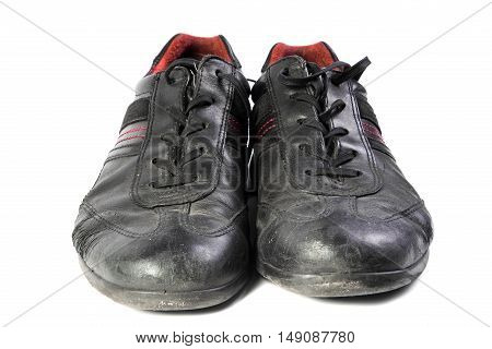 worn black men's shoes on a white background