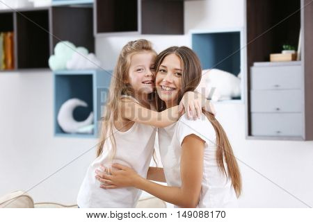 Cute girl with mother at home