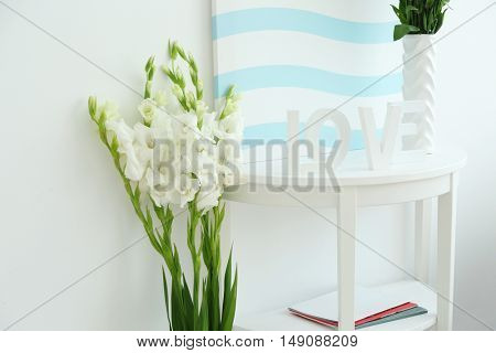 Contemporary interior with bouquet of flowers in vase, close up